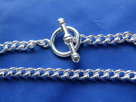 Silver plated bracelet with heavy toggle clasp.